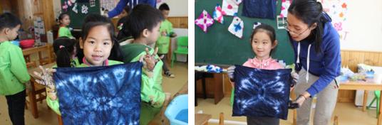 扎染活动中,老师指导幼儿学习扎染的方法,幼儿先尝试用宣纸制作扎染